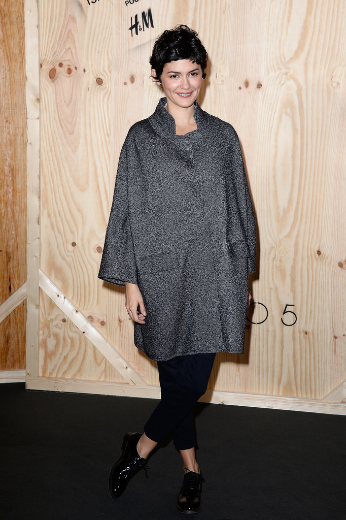 Audrey Tautou combined an oversize cocoon coat with cropped black pants at the Isabel Marant for H&M photocall in Paris.