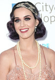 At a benefit later that same year, Katy went with silvery plum locks that she tucked into a faux bob for a vintage style.