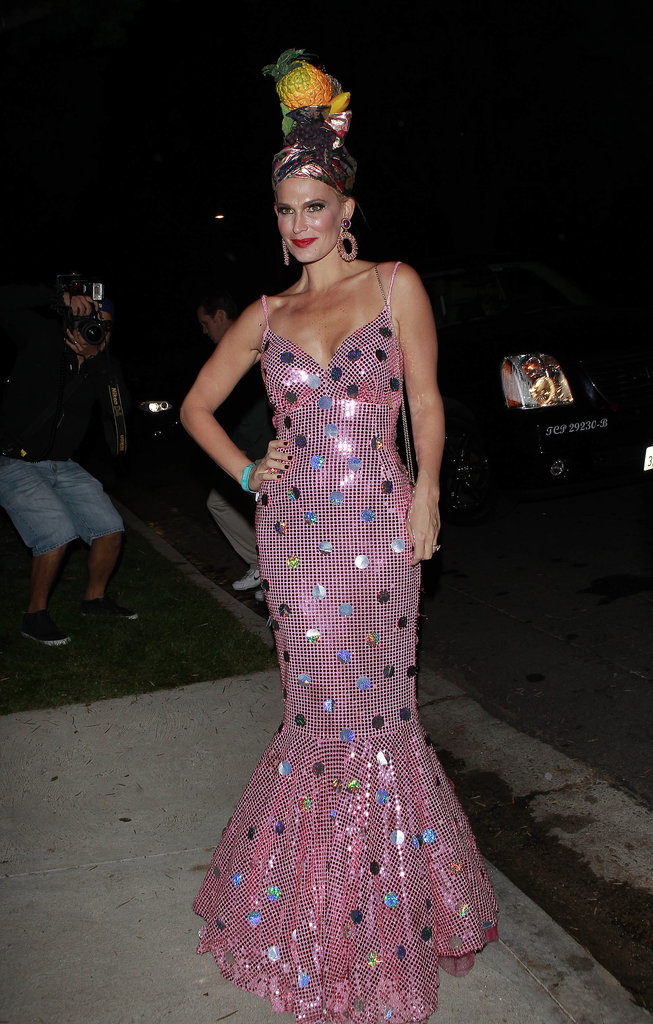 Molly Sims worked a Miss Chiquita Banana-inspired costume in a sequined fishtail gown and a tropical headpiece.