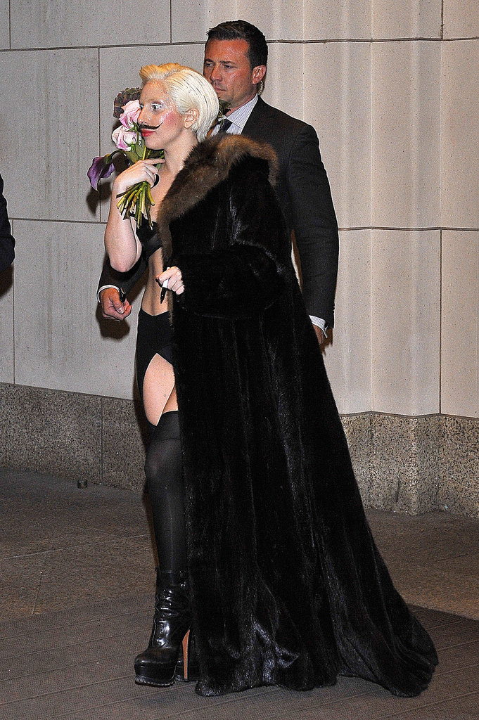 It's another bold Lady Gaga look; this time she added a mustache to lingerie and a coat while out in Berlin.