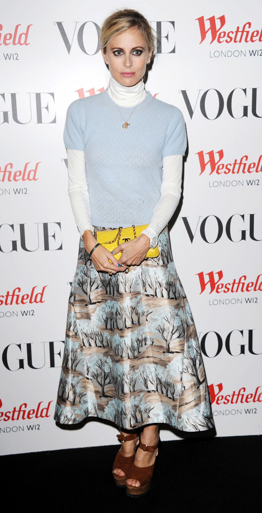 Laura Bailey layered preppy separates and added a bold yellow clutch at Westfield's London bash.