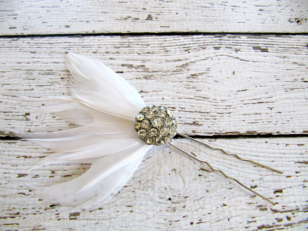Just a touch of feathers, courtesy of this feathered rhinestone hair pick ($17), can add instant pizazz.