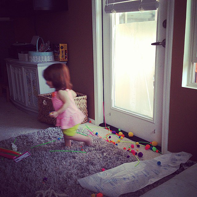 When she was supposed to stick the puff balls and pipe cleaners onto the contact paper on the door but had other plans instead. Source: Instagram user elizabeth_a_howard
