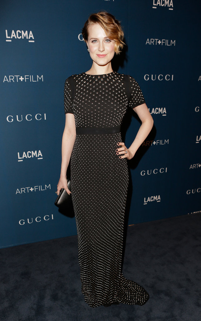 In her first red carpet appearance since giving birth, Evan Rachel Wood attended the LACMA gala in a fitted, gold-studded black Gucci gown.