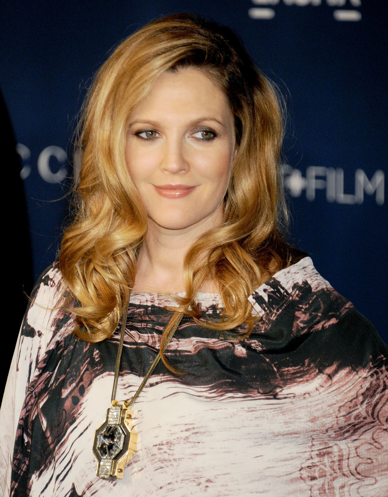 Drew Barrymore had a head full of voluminous curls on the LACMA red carpet. Her warm makeup palette matched her strawberry blond hair perfectly. Perhaps, her stunning complexion is due to her pregnancy glow?