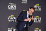 Tom Hiddleston tried to eat his MTV Movie Award.