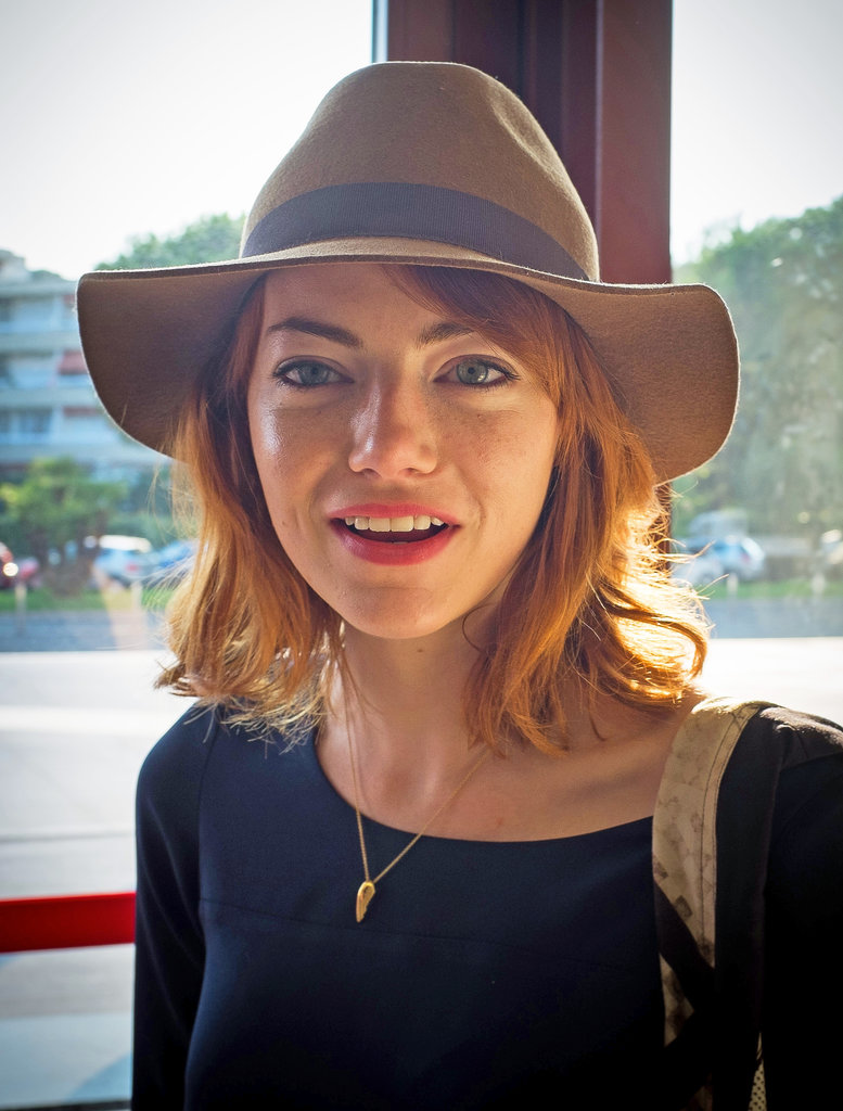 By the Summer of this year, Emma was back to sporting her signature, red hair color.