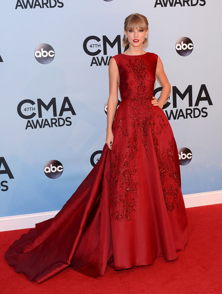 Taylor Swift hit the red carpet in a red gown at the CMAs.