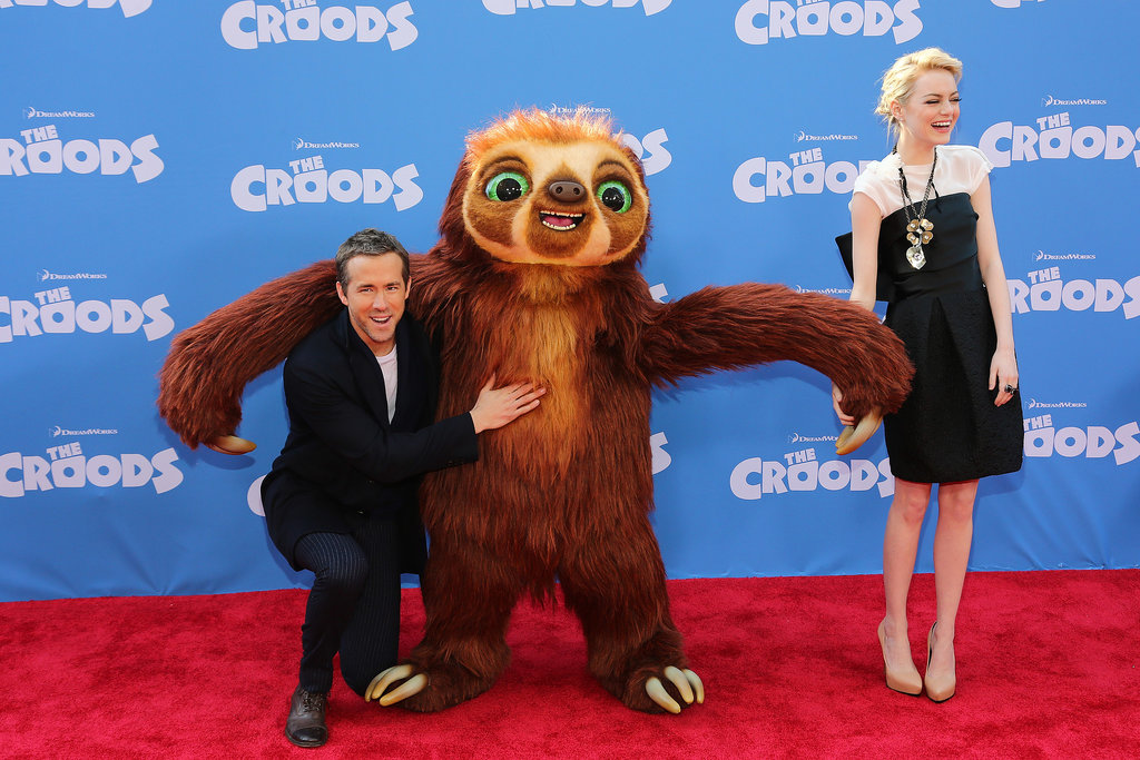 Emma laughed on as her The Croods co-star Ryan Reynolds hammed it up with their furry mate at the film's New York premiere this year.