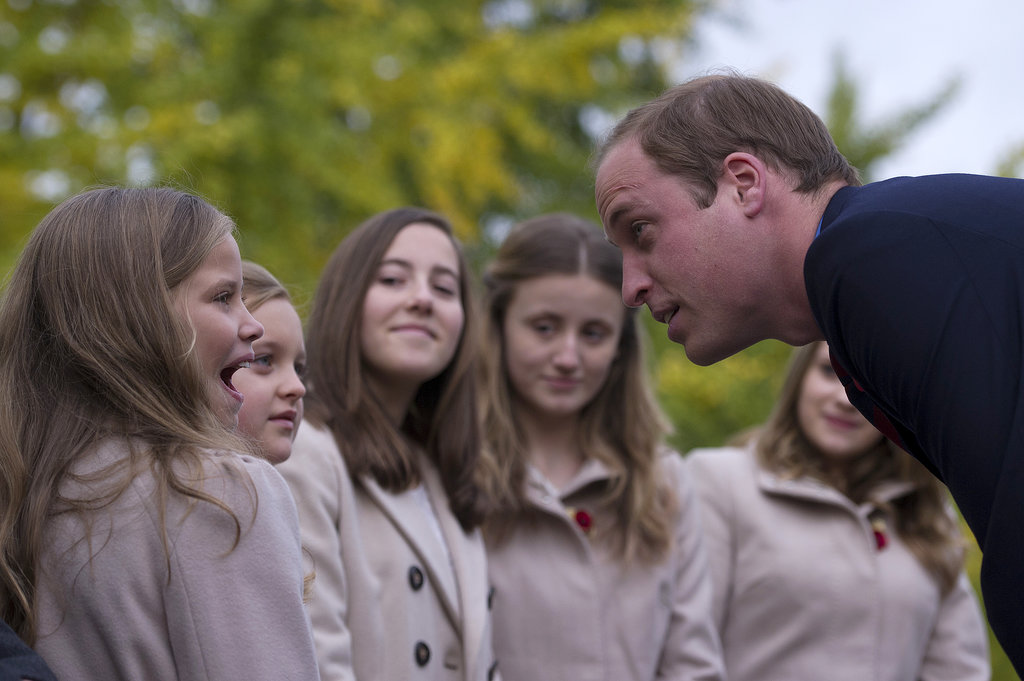Prince William chatted with young schoolgirls.