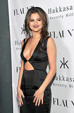 Selena Gomez showed off her sexy side at Flaunt magazine's November issue party in LA on Thursday, sporting a body-hugging black dress with a low neckline.