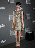 Anne Hathaway tapped into her glam side in a gold metallic Gucci minidress and equally shiny rhinestone sandals for the Costume Designers Guild Awards in February 2013.