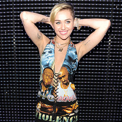 Miley Cyrus Hits The MTV EMAs in a Mini Dress and Boots