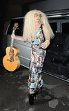 Lady Gaga was spotted again in London wearing a dress adorned with Botticelli's Birth of Venus. She accessorized her outfit with a guitar and a pair of goggles.