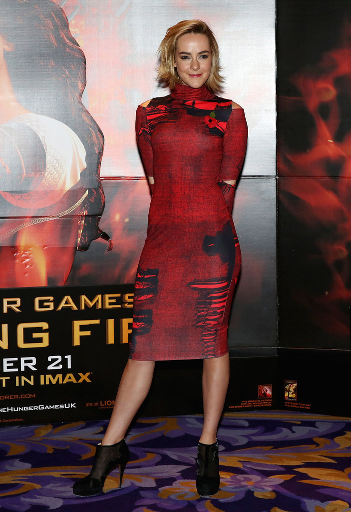 Jena Malone chose an appropriately fiery red ASOS sheath and black booties at a photocall for Catching Fire in London.