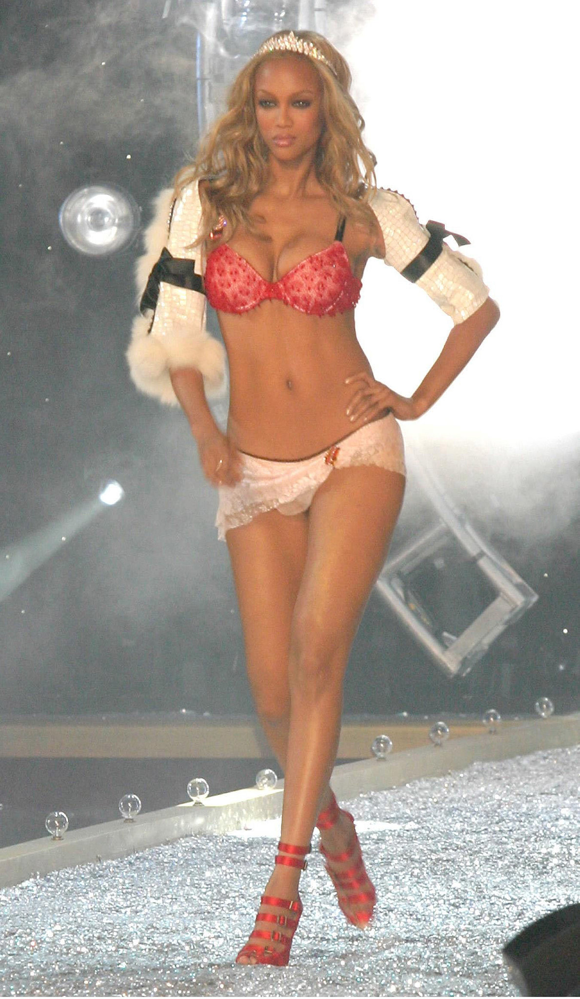 Tyra Banks wore a sexy shrug and tiara in 2003.
