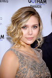 Elizabeth Olsen turned a midlength cut into a wavy faux bob by keeping curls loose and only starting them from the ear down. This way, the hair doesn't bounce up too much, and the finished look is looser and more modern.