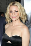 Beachy waves and a center parting gave Elizabeth Banks' faux bob a laid-back look. Shorter layers at the front hung loose while the back was rolled up and pinned at the neck.