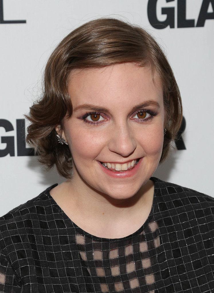 A pink and purple shadow combination was the focus of Lena Dunham's makeup look last night. Her hair was styled in loose waves with her bangs tucked out of her face with a single bobby.