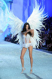 Adriana Lima kept her balance on the catwalk, despite wearing massive wings.