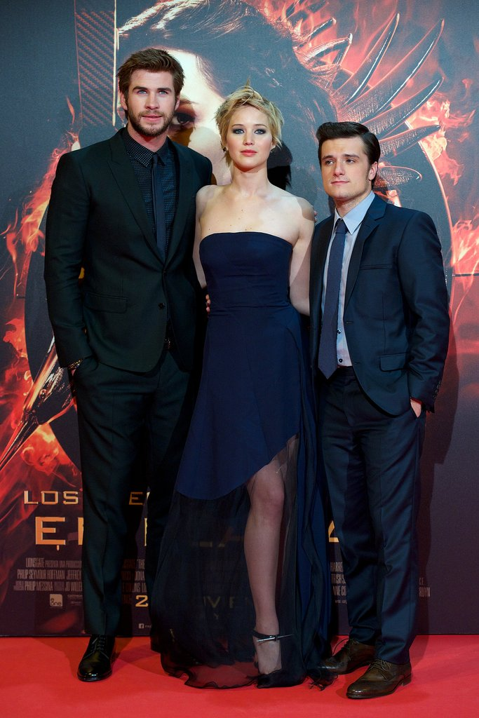 Liam Hemsworth, Jennifer Lawrence, and Josh Hutcherson got together for the cameras at the Madrid premiere of Catching Fire.