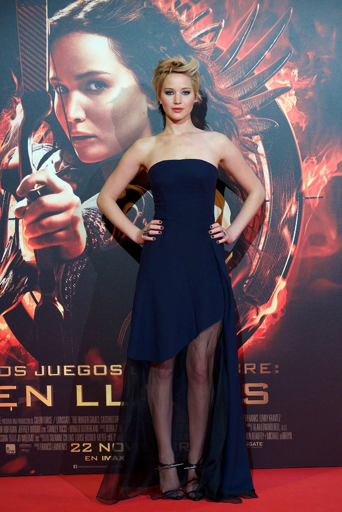 One more for Dior! For the Madrid premiere, Jennifer Lawrence chose a blue, silk bustier dress with a sheer front panel that showed off a little leg. Ana Khouri made her black diamond earrings.