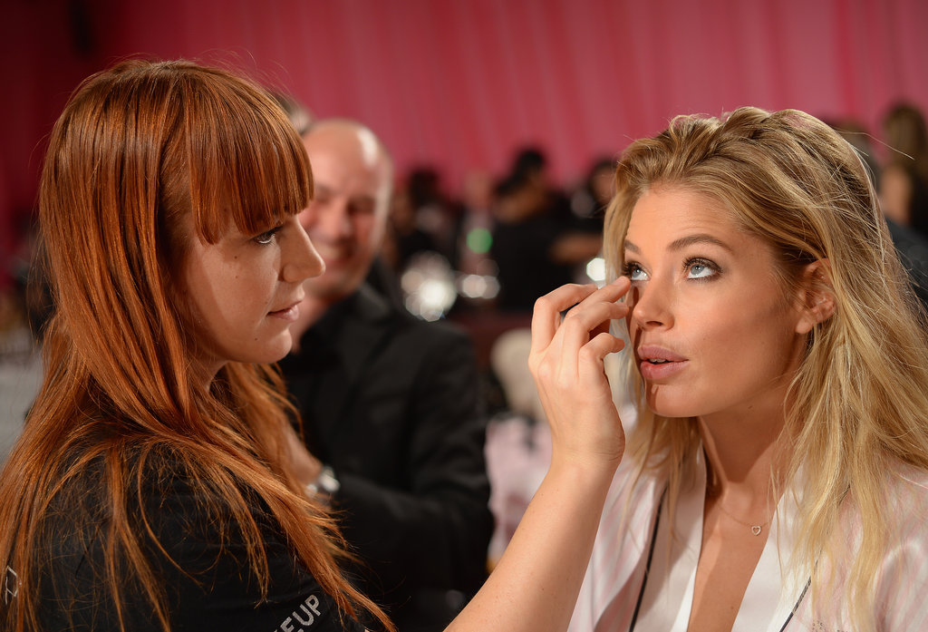 Doutzen Kroes patiently waited for her stylist to perfect her makeup.