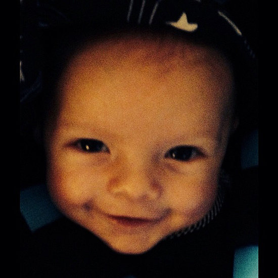 Axl flashed his mom an adorable smile.  Source: Instagram user fergie