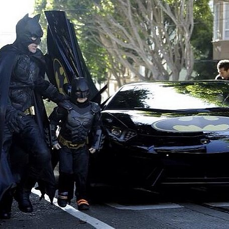 Batkid exited his cool Batmobile with his helper. Source: Instagram user ryoj