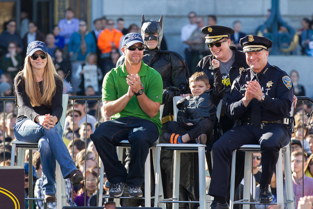 Batkid Miles Scott celebrated with his parents and the city's fire and police chiefs.