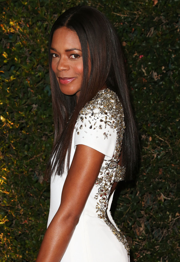 Lighting up the red carpet in a brilliant white gown, Naomie Harris opted for long, straight locks with a natural makeup palette.
