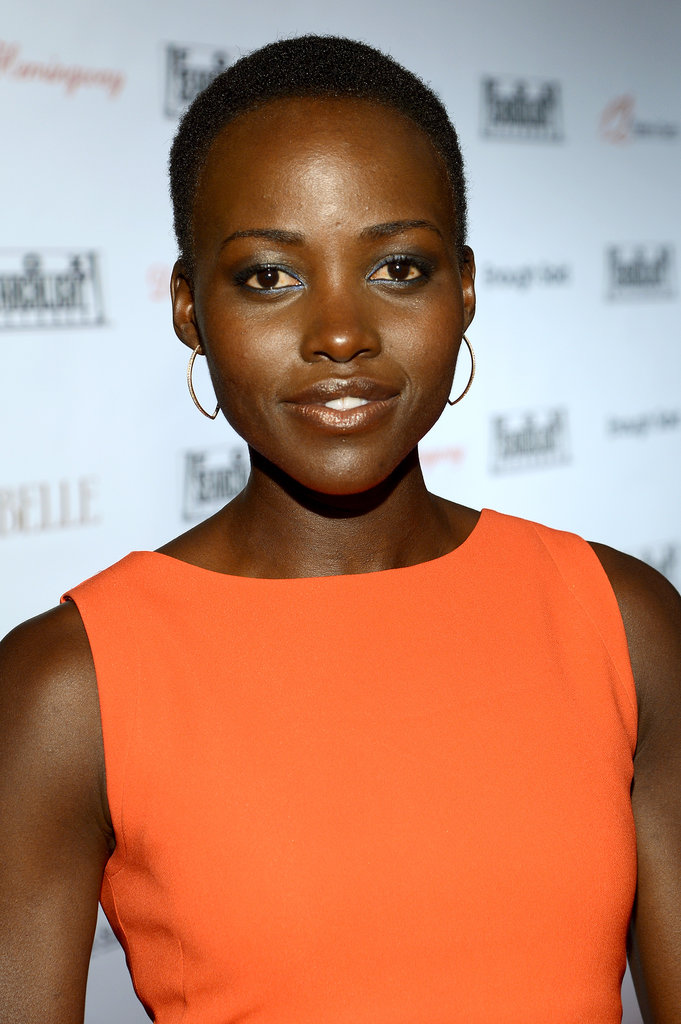 Blue shadow and an orange dress may not seem like a typical combination, but at the Fox Searchlight party at the Toronto International Film Festival, Lupita pulled it off.
