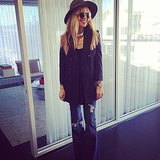 "Rachel Zoe posed for a photo while describing her ""perfect casual look"" of wide-leg jeans and a blazer from her own collection. Source: Instagram user rachelzoe"