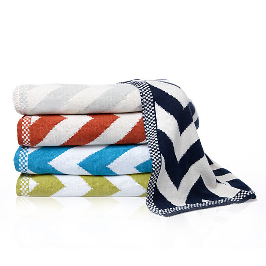 Chevron-Pattern Knit Throw The classic chevron print of this throw paired with the soft, warm feel will make you want to curl right up on your comfiest chair. It will make a chic addition to any room. *Color may vary.