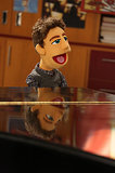 Mr. Schuester gets his own muppet.