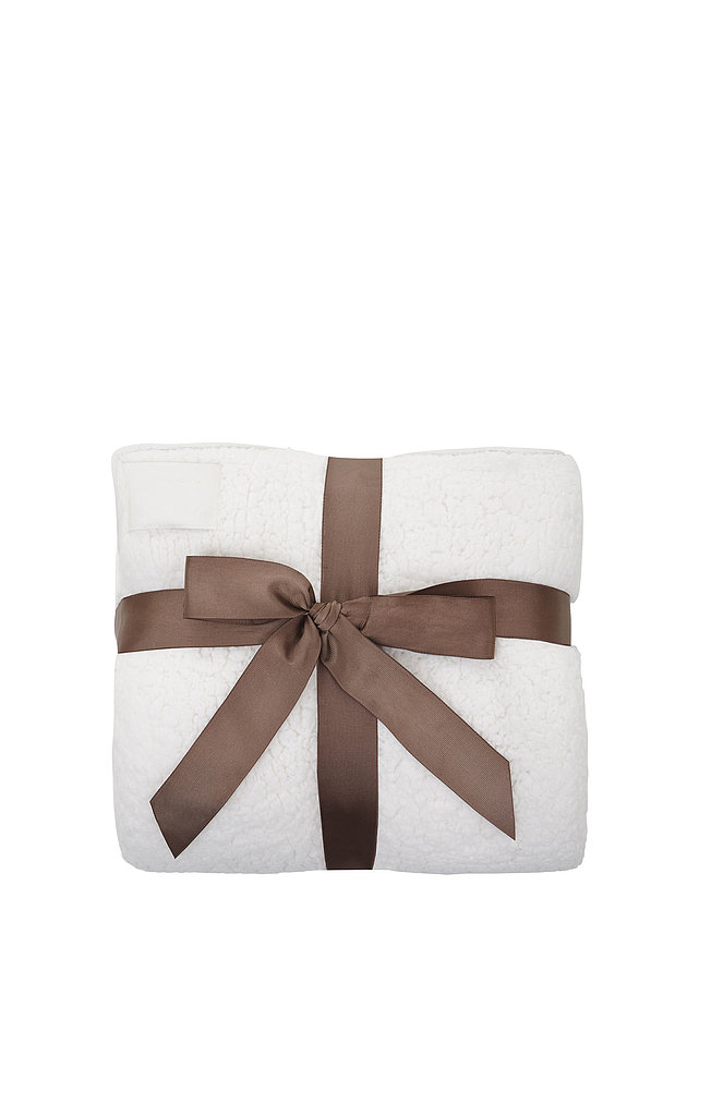 "BCBG Max Azria Dreamie Blanket With Leatherette Edge ($98) ""This blanket is so comfortable and great for traveling."""