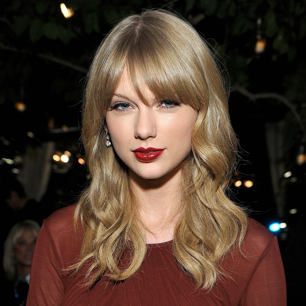 If you're already a fan of red lipstick like Taylor Swift is, then try out a deeper burgundy hue for the holiday season.