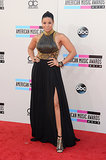 Hello, legs! Jordin Sparks struck a fierce pose in an edgy black gown comprising a leather gold-armored bodice and flowing side-slit skirt.