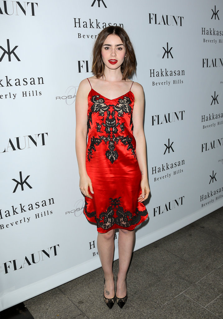 Lily Collins's slinky red dress would just need a furry topper to take it out to your holiday fete of choice.