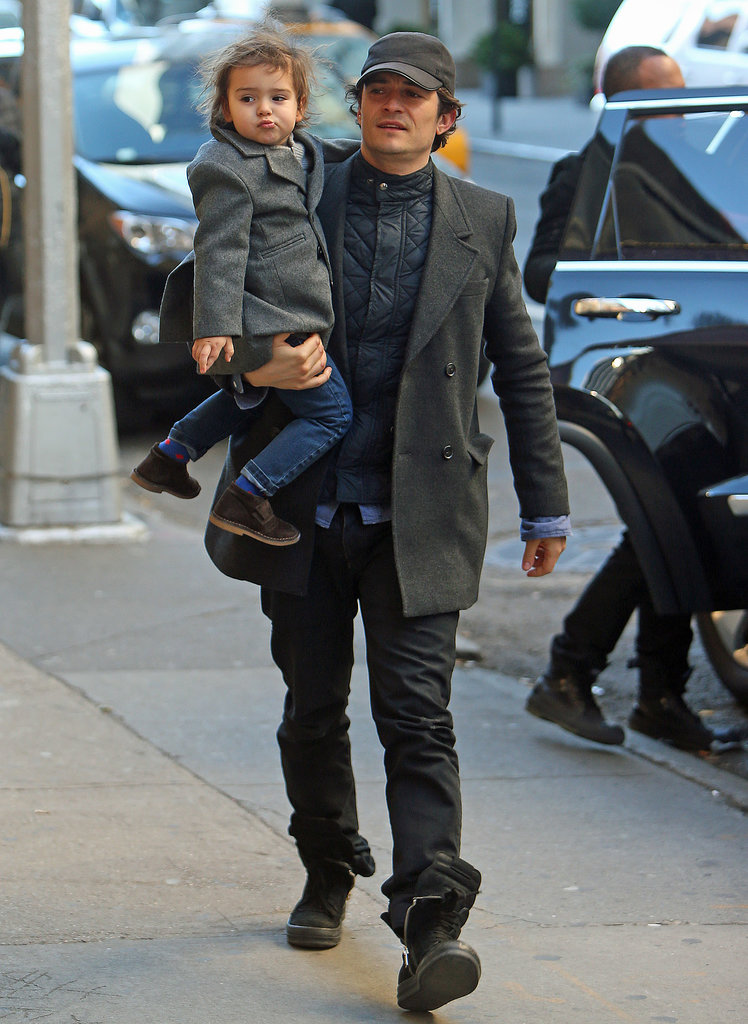 Orlando and Flynn matched in grey coats during a stroll in NYC in November 2013.