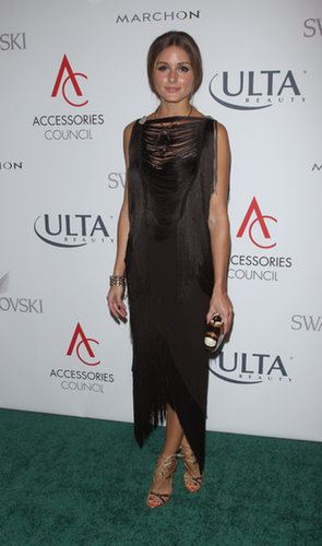 At the ACE Awards, where she took home a prize for distinguished style, Olivia showed off her fashion sense in a black sheath and bold accessories.