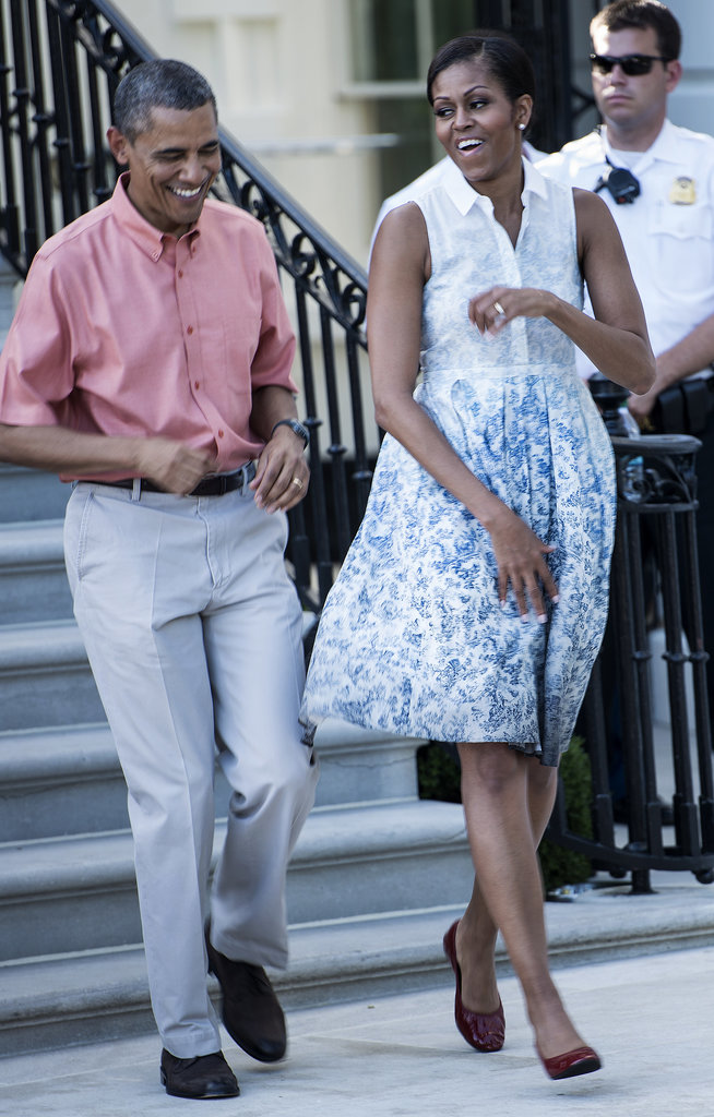 Michelle and Barack got a case of the giggles on the Fourth of July while celebrating on the White House South Lawn.