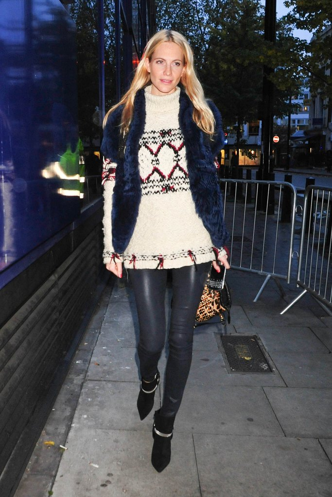 In lieu of a jacket, Poppy Delevingne covered up in London with a midnight-blue fur vest.