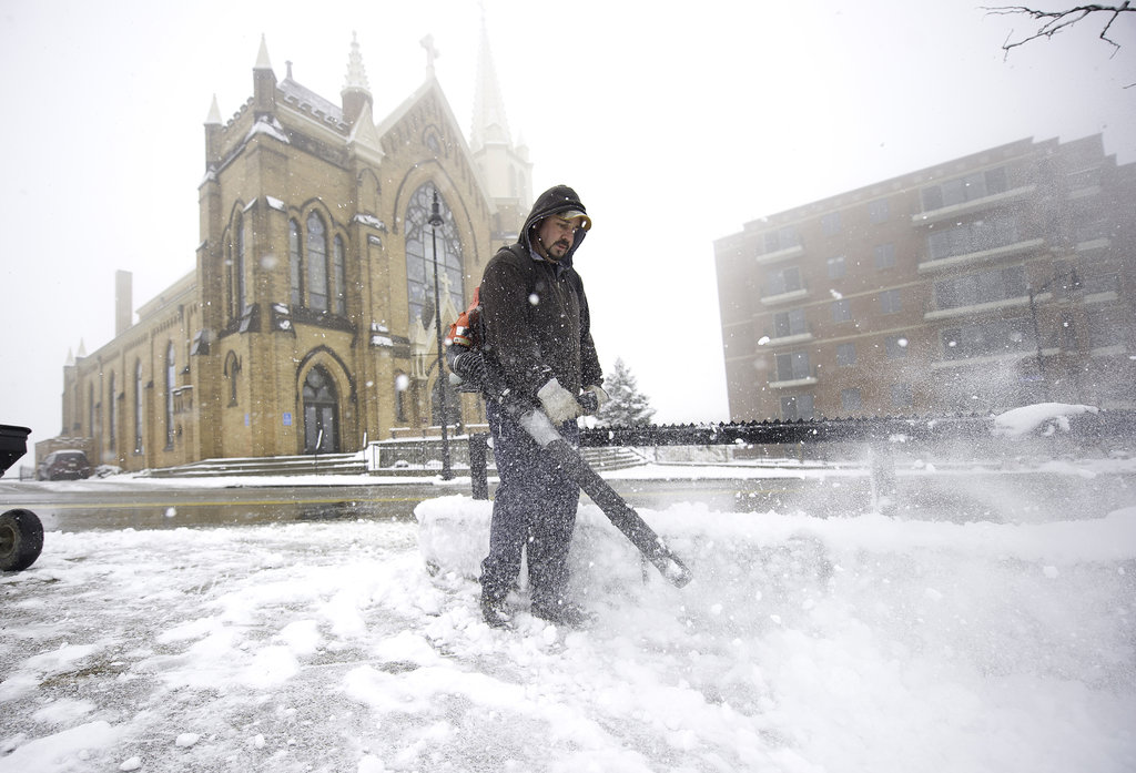 Snow poured down in Pittsburgh, PA, making travel dangerous.