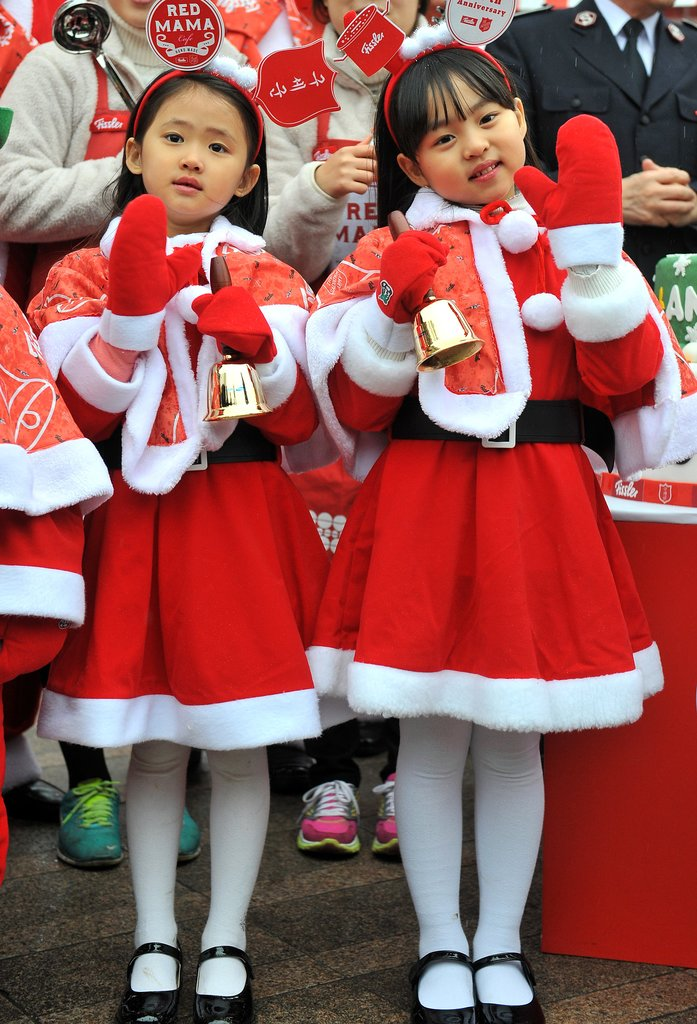 In South Korea, Santa's little helpers helped raise money for charity.