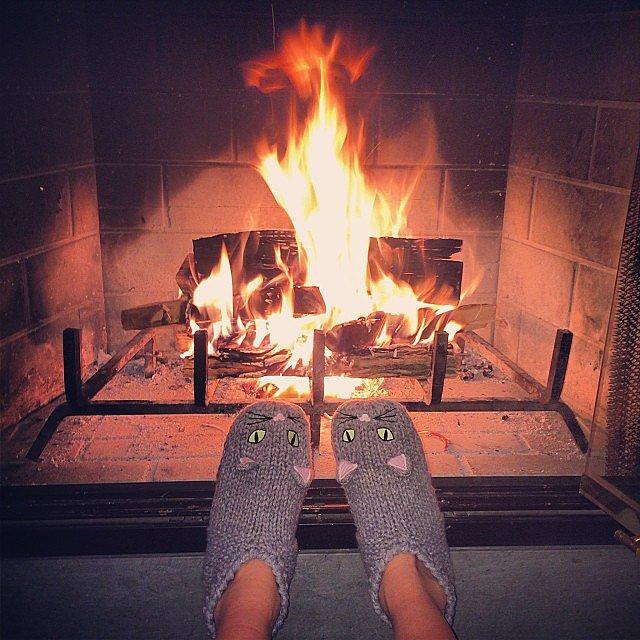 Nicky Hilton stayed warm near the fireplace. Source: Instagram user nickyhilton