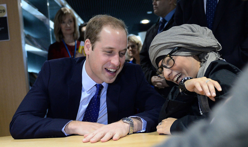 Prince William met with a young woman at the library during his visit.