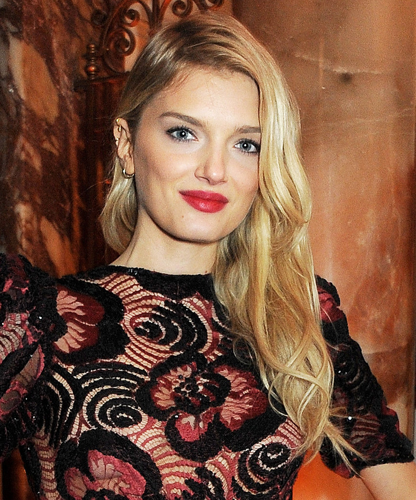 Model Lily Donaldson wore her hair in tousled waves over one shoulder.