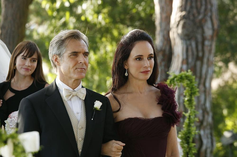 Conrad (Henry Czerny) and Victoria watch as Emily officially becomes a part of the family.