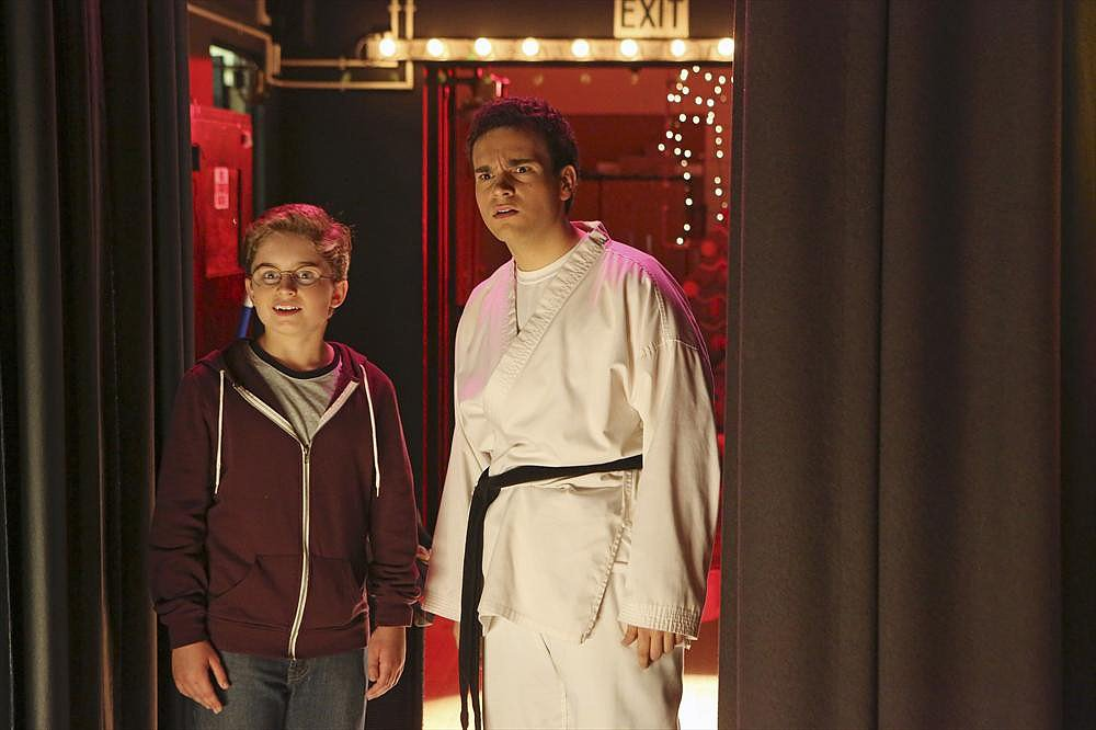 "The Goldbergs Adam (Sean Giambrone) and Barry (Troy Gentile) hide backstage at their school's holiday talent show in ""Kara-Te,"" airing Dec. 10 on ABC."